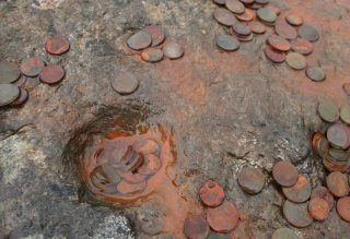 Coins on Stone at St Columba's Birthplace