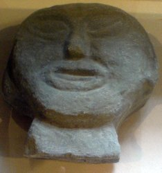 Stone head on display at visitor centre